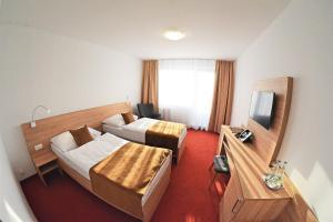 Posteľ alebo postele v izbe v ubytovaní Alexandra Šport Hotel