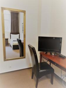A television and/or entertainment center at Hotel Praha