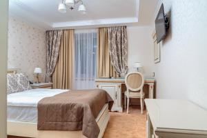 Cama o camas de una habitación en Hotel Polonez