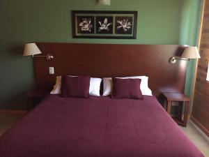 Una cama o camas en una habitación de Encanto del Rio