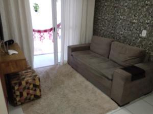 A seating area at Espaço Relax em condominio clube