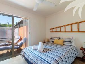 A bed or beds in a room at Aqua Apartment #3