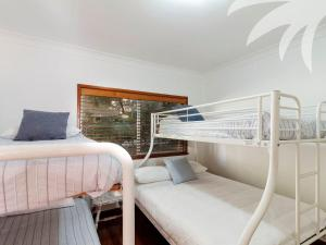 A bunk bed or bunk beds in a room at Picturesque Lizzie Palms 1