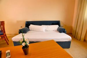 A bed or beds in a room at Alicante Hills Apartment