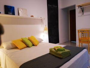 Cama ou camas em um quarto em Casa do Sol