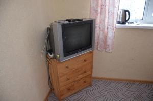 Телевизор и/или развлекательный центр в Парк-отель Озеро Великое