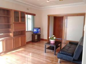 A television and/or entertainment center at Ideal Business and Family accommodation