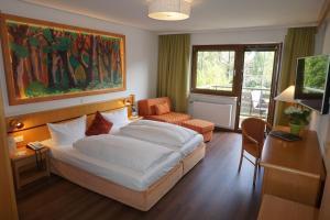 Ein Bett oder Betten in einem Zimmer der Unterkunft Flair Hotel Hochspessart