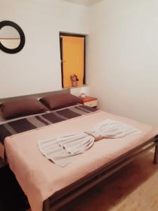 A bed or beds in a room at Apartments Lola
