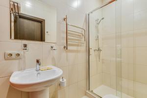 Ванная комната в Отель РОТАС на 7-й Красноармейской