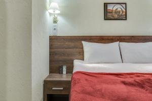 Кровать или кровати в номере Отель РОТАС на 7-й Красноармейской
