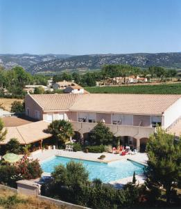 A view of the pool at Hostellerie Saint Benoît or nearby
