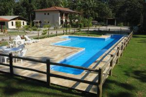 The swimming pool at or near Pousada Praia de Itamambuca