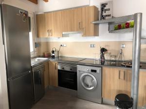 Una cocina o zona de cocina en El 1 de Amador de los Rios