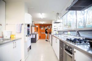 A kitchen or kitchenette at City Lodge Accommodation