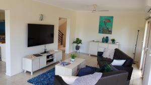 A television and/or entertainment center at Beach House on Begley - Airlie Beach Central