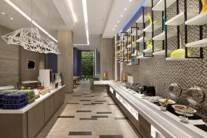 A restaurant or other place to eat at Holiday Inn Express Jakarta Wahid Hasyim, an IHG Hotel
