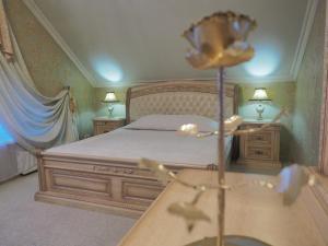 Кровать или кровати в номере Парус Парк-отель