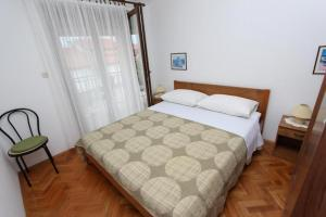 A bed or beds in a room at Apartments Fabris