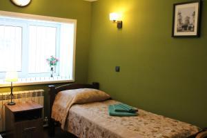 Кровать или кровати в номере мини-отель Медведов