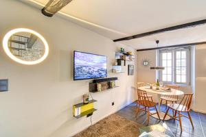 A television and/or entertainment center at Amazing Chic Apt in Le Suquet by GuestReady