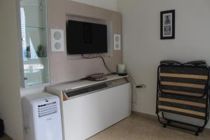 A television and/or entertainment center at Colony Beach Mediterranean