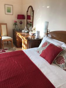 A bed or beds in a room at The Aldwick