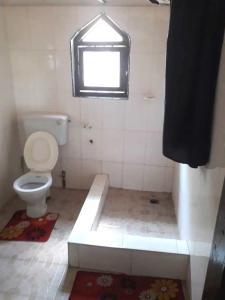 Salle de bains dans l'établissement Ayikoo Beach House