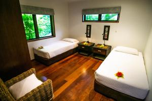 A bed or beds in a room at Qamea Resort & Spa