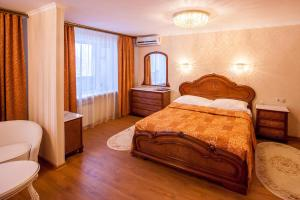 A bed or beds in a room at Hotel Ob