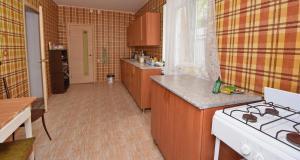 Кухня или мини-кухня в Гостевой Дом Малина