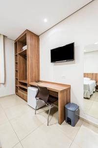 A television and/or entertainment center at Serata Hotel