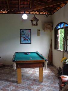 A pool table at Recanto dos passaros