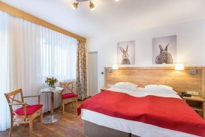 Ein Bett oder Betten in einem Zimmer der Unterkunft Hotel Diana