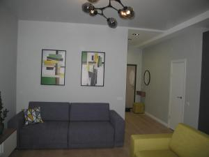 A seating area at Dynasty Studio Apartment