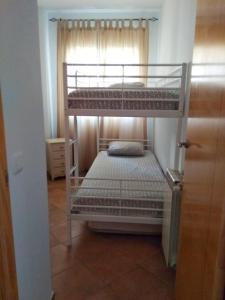 A bunk bed or bunk beds in a room at Islantilla-Apartamento con piscina y garaje en primera línea de playa