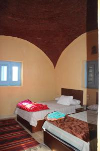 A bed or beds in a room at Zaytona Lake View