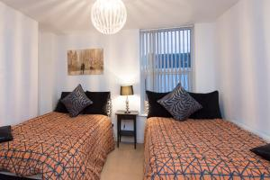 A bed or beds in a room at Town House Liverpool