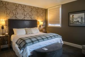 A bed or beds in a room at Sentinel, a Provenance Hotel