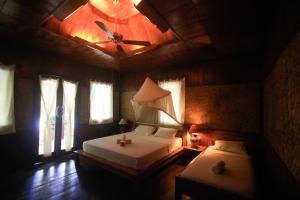 Кровать или кровати в номере Sejuk Cottages