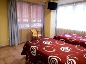 Cama o camas de una habitación en Hotel Patilla