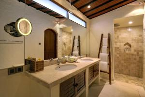 A bathroom at Impiana Private Villas Seminyak