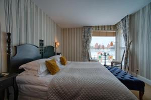 A bed or beds in a room at Apvalaus stalo klubas