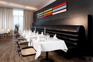 Ein Restaurant oder anderes Speiselokal in der Unterkunft Dorint Sanssouci Berlin/Potsdam
