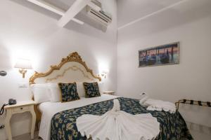 Cama ou camas em um quarto em Al Mascaron Ridente