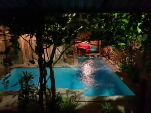 A view of the pool at Nextdoor Homestay or nearby