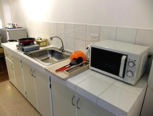 A kitchen or kitchenette at Himawari Hotel