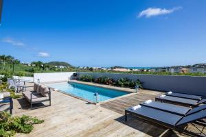 The swimming pool at or near Villa Jwi Lavi Boutique Hotel