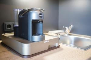 A kitchen or kitchenette at Hotel dasPaul