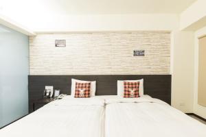 ホーム レスト ホテルにあるベッド